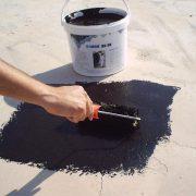 bitumen coating aanbreng op plat dak