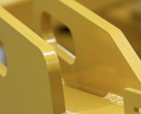poedercoating verwijderen gele staalconstructie